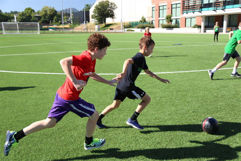 Kids play soccer on the Rec Center turf fields.