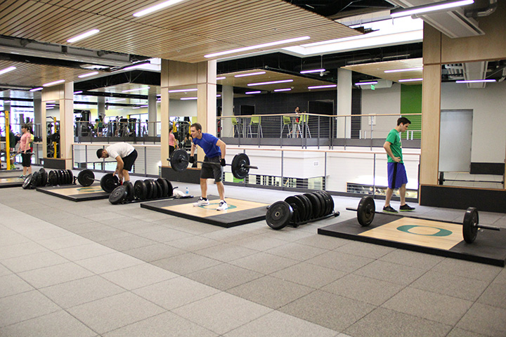 People lifting weights in the Rec Center.