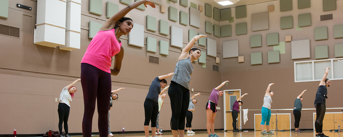 A group of students stretch after an UrbanKick Group X class