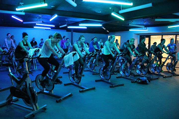 Spin class with special blue lighting.